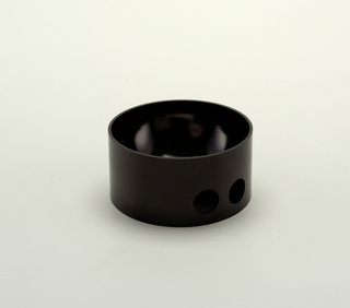 Concave circular bowl with short cylindrical wall perforated with pair of small circular holes as finger grips near base.