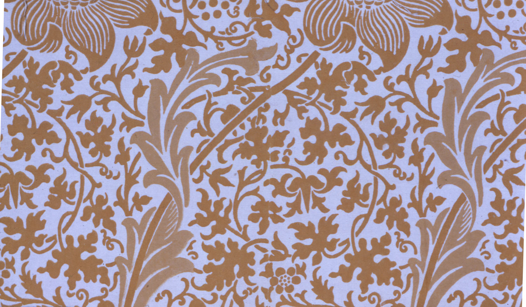 Large-scale design of long-stemmed flowers leaning diagonally, on a ground of small all-over twining vines, leaves and flowers. In two shades of golden tan on white. Wide plain unprinted selvedges.