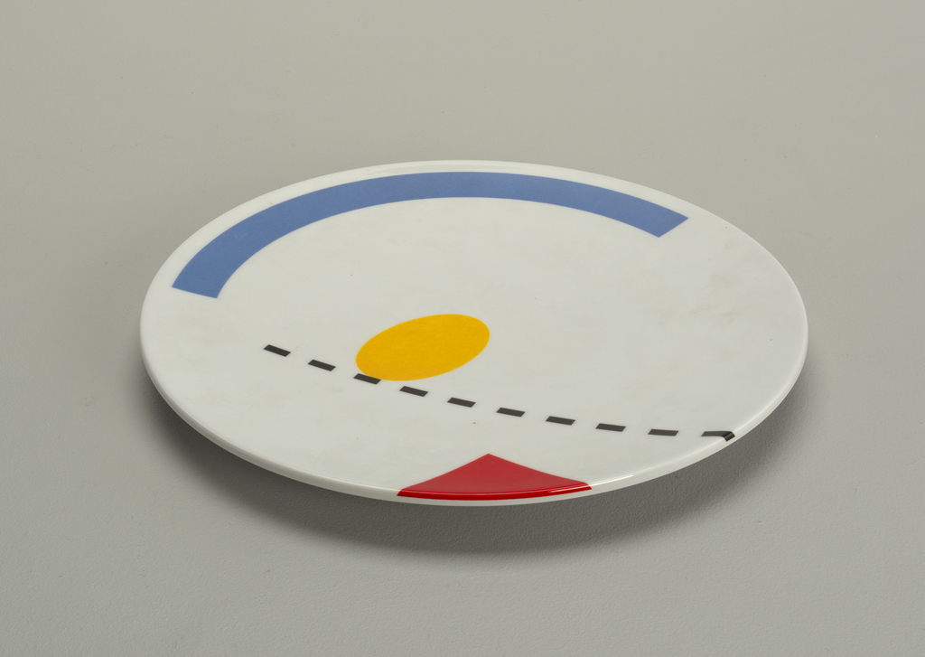 Blue, yellow, red, black on white background dinner plate.