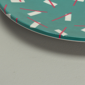 White and pink on turquiose salad plate.