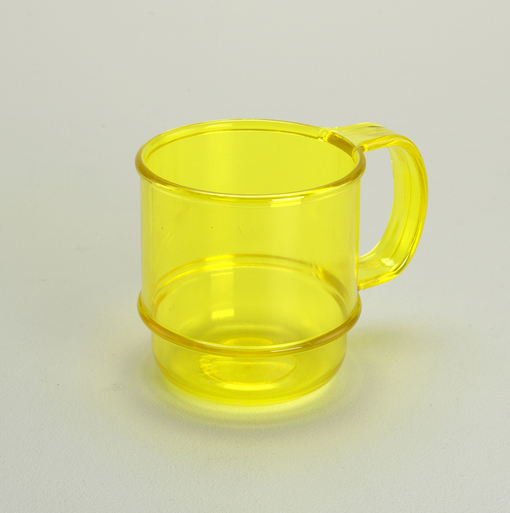 Transparent yellow mug with horizontal molded bands and handle