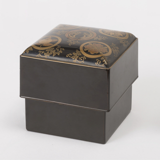 Square black lacquer box (a); square black lacquer lid (b) with deep sides, slightly domed top having gilded decoration of five circular crests and foliate scrolling.