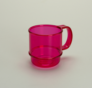 Transparent fuschia mug with molded horizontal bands and handle