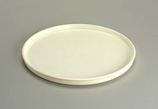 Opaque white plate with lip