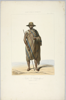 Man stands facing front, on flat ground. He wears a heavy brown blanket with red and blue stripes. Title and artists' names below.