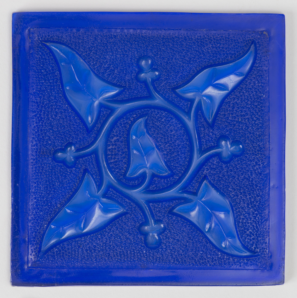 Blue square with flat border. Relief design of a vine with four leaves forming a circle, on a textured ground.