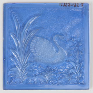 Blue. Framed by plants, or swan floats on a pond.