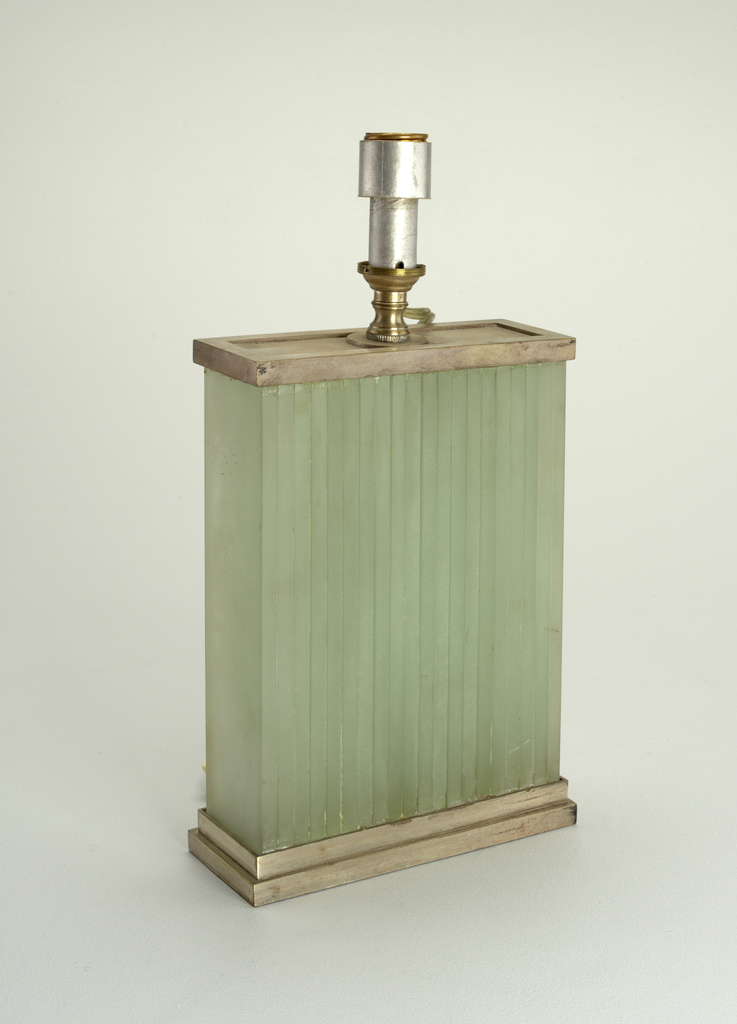 Base of green glass with silver mounts and parchment shade.