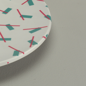 Turquoise and pink on white plate.