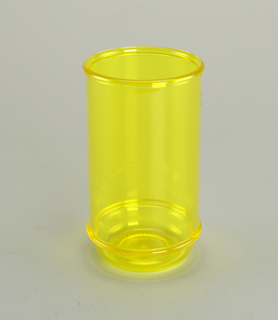 Tall, translucent yellow tumbler with horizontal molded bands