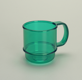 Transparent green mug with molded horizontal bands and handle