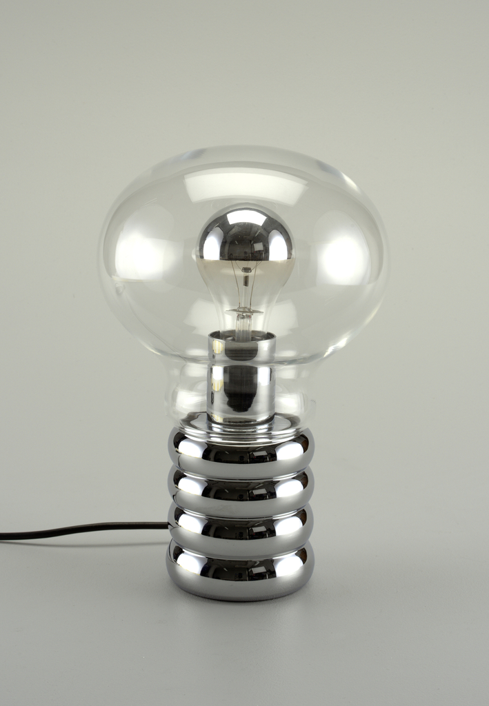 Light bulb-shaped clear glass globe enclosing clear glass light bulb with silvered top; cylindrical, chromed metal base in shape of socket with horzontal ridges.