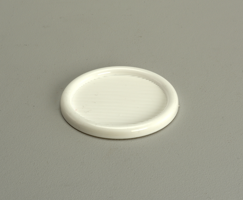 Opaque, white, semi-rigid coaster with 3-inch diameter well