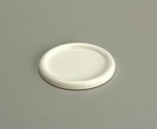 Opaque, white, semi-rigid coaster with 3-inch diameter well