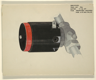Black cover with red label and white lettering over metal gas valve.