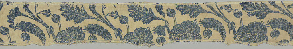 Valance resist printed in two shades of blue in a design of undulating branches with large cup-shaped blossoms and curling leaves with pendant fruit. Three points on lower border. Edged with cotton tape, white with a narrow border of blue on either edge. Backed with sateen.