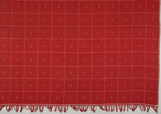 Square shawl of fine red wool with warp fringe. Thin cream-colored cross-stripes form large squares, each with a small floral motif in white, black and green.
