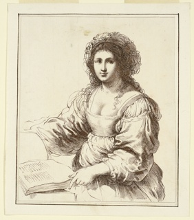 Young woman facing frontally, her book to the left on a table.