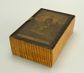 """a) Rectangular wood box, covered with paper simulating wood grain. b) Flat cover with attached ribbon and """"View of the Merchants' Exchange, Wall St. New York . . . """""""