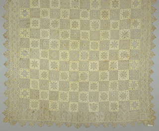 Checkerboard arrangement of squares of punto in aria with geometric motifs alternating with squares of fabric which have rosettes cutouts filled in with needlelace. Border of punto in aria. Scalloped needlelace edging.