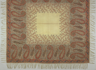 Square cream-colored shawl printed in strong shades of pink, blue, green, and brown with a deep border of large, vertical stylized cones on a ground of close-set flowering branches; more trees rise from these into field. Cone and floral guard borders.