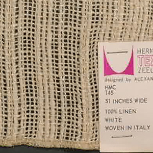 Plain and gauze weave in white. Warp is comprised of thin threads and a heavier 2-ply yarn. Yarn is used in the areas of plain weave. Weft is comprised of thin threads.