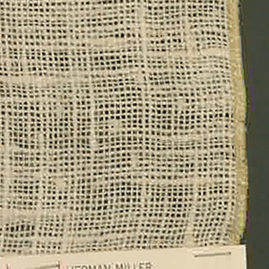 Plain weave in white. Some of the warp and weft threads are coarsely twisted and give an irregular surface appearance.