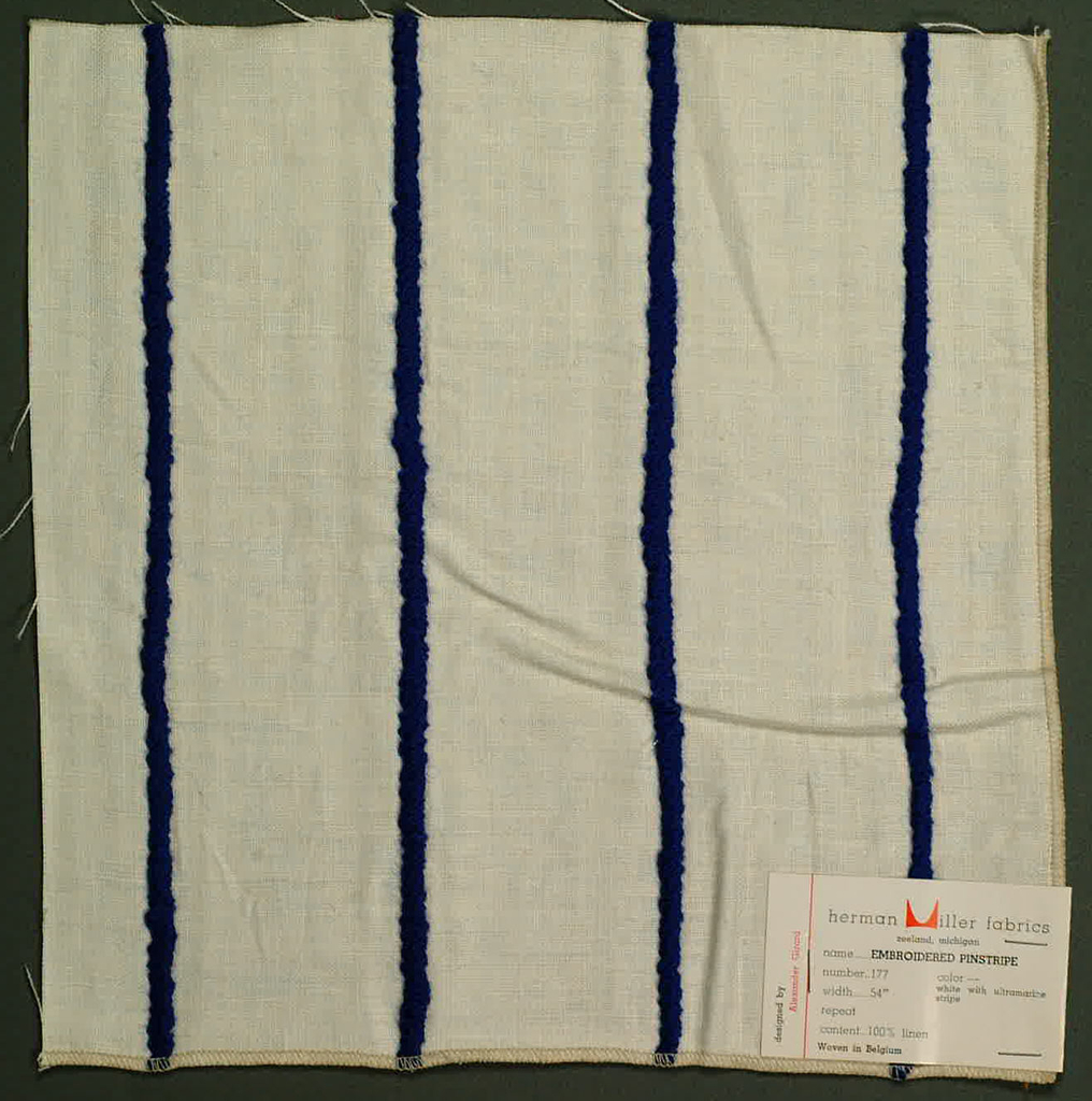 Plain weave in white with applied stripe in blue yarn. Yarn is looped and stitched to the surface of the plain weave.