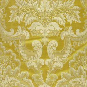 Canary yellow ground showing a design in ivory of diapered scrolls forming ogives and enclosing floriated leaf palmettes.