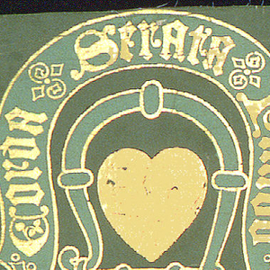 """Major motif a gold heart enframed by a fetterlock with accompanying motto: Corda Serata Pando. In staggered relationship to this, a circular medallion contains the letter """"M"""" superimposed on the letter """"L"""". Twisted rope embellishments connect monograms. Printed for Lady Macdonald Lockhart for use at Lee Castle, Lanarkshire. On verso is stamped almost illegibly: """"John G. Crace / 14 Wigmore Street."""""""