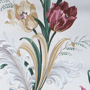 Red, pink, and yellow tulips with green and yellow together with tan and white feather plumes held by a blue bow on a beige ground.