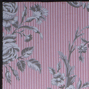Formalized composition with arabesque elements. Single motif of vase containing roses, carnations and other flowers. The same motif is arranged so as to connect with itself by a flowering arabesque and the distribution is in diagonal form. Pink ground is shiny and is striped vertically with narrow, light pink bands. Printed in grisaille on pink ground.