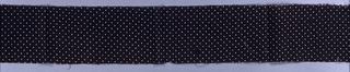 White pin dots on a dark brown ground.
