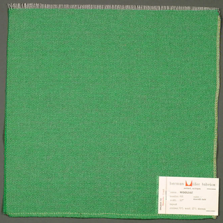 Plain weave in bright green. Warp is comprised of fine white threads while the weft has heavier bright green yarns. Number 436.