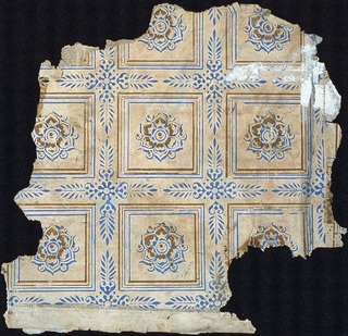 """Tile pattern, with each tile containing a rosette in the center. Anthemion motif separating tiles at corners. Printed in blue and brown on tan paper. The paper is backed with newsprint. Inscribed in graphite on recto: """"Galligan '51""""."""