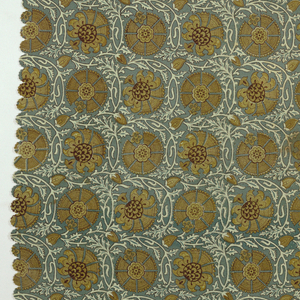 Cover, printed on one side only, with all-over geometric diaper pattern constructed on circular lines. Highly stylized flowers in olive-green with dark red details are encircled by pale blue-green vines on darker blue-green ground.