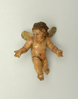 Cherub with outstretched arms, one leg forward, head facing to his right. Painted accents on wings. .