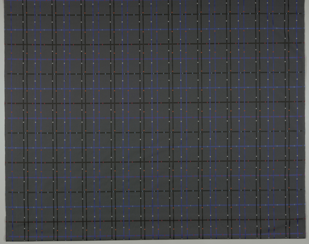 Grid of lines interrupted by small blocks of a contrasting color at regular intervals. Reversible. Dark grey ground.