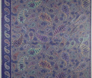 "Spiky ""paisleys"" on a blue ground with squiggles, bright colors. Border on left side."