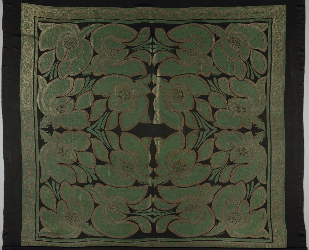 Bold floral pattern with large blossoms surrounded by a narrow scroll border in green and gold on a black background.
