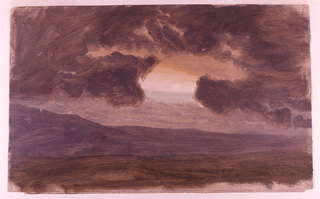View of black clouds in the center revealing a sunset.  Distant hills appear lavendar.  Foreground devoid of distinct vegetation.