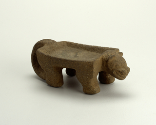 Metate in the form of a jaguar.