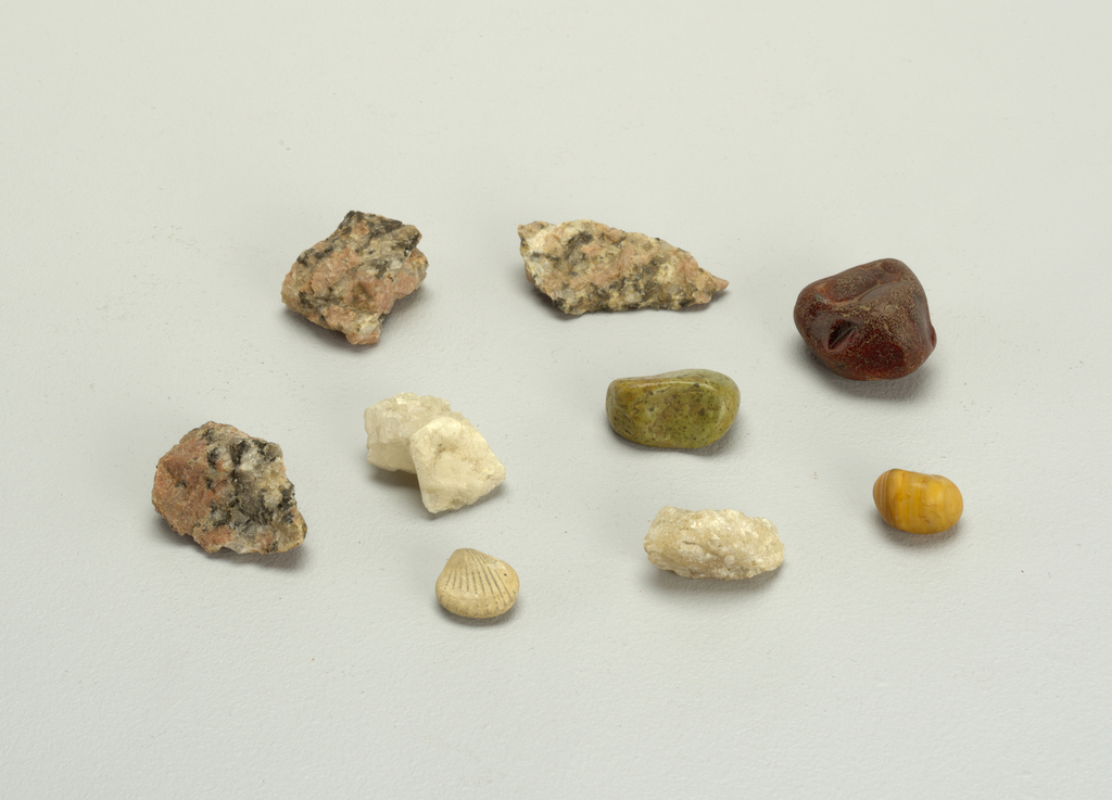 two pieces of white crystalline quartz; three pieces of rose quartz; one whole and one broken piece of red and white agate; one green and one yellow pebble - these originally part of a set of 20, but 11 of the original set were deaccessioned: See: 1951-185-31-j/t.