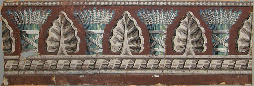 Alternating wheat bundles and large leaves above ribbon twist on cable, with strung beads along the top. Printed in grisaille, green and blue with a brown ground.