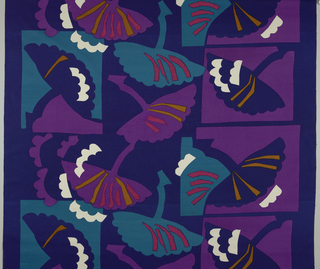 Allover pattern of fan-like shapes—some contained in squares, based on negative/positive cut outs.  Dark blue background with purple, medium blue, magenta, yellow ochre, and ivory.