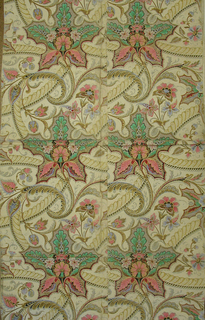 Chintz or India-inspired design. Brightly colored exotic flowers interspersed with bands of foliate motifs having appearance of cable twists. Printed in green, pink, gray, red, blue, yellow ocher and black on off-white paper.  Appears to be printed on ungrounded cotton rag paper.