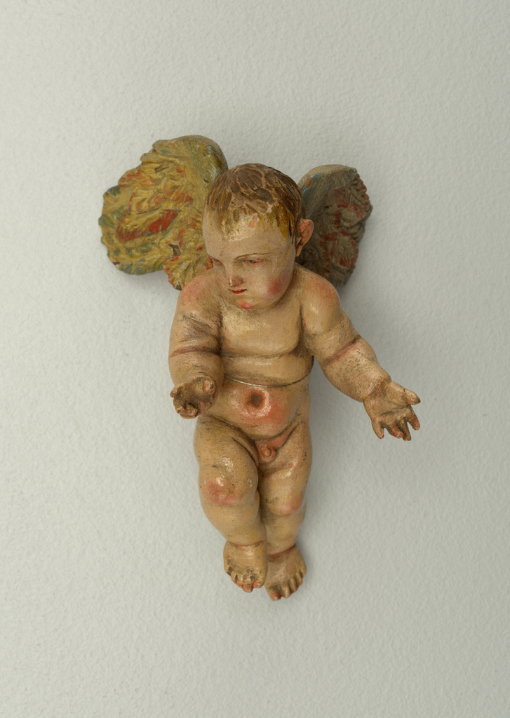 Cherub with outstretched arms, one leg forward, head facing to his right.  Pained wings.
