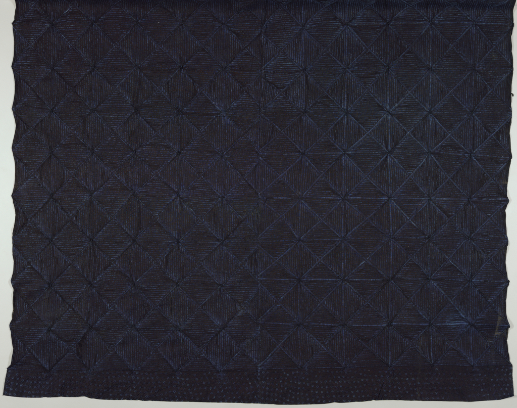 Length of deep indigo--dyed cotton with an all-over grid of diamonds, each filled with horizontal or vertical bars, in light blue. Design created through the stitched-resist method.