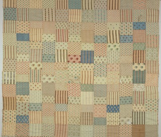 Unmade quilt of approximately 144 squares of challis wool (5 x 5 in.) stitched together to form a large square. In pastel and faded colors, either small allover geometric, floral patterns or a variety of stripes. There are a few duplicates.