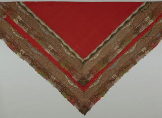 Square shawl with red center or field made to folded on a diagonal and worn as a triangle. Inner border has Kashmir woven strips with Kashmir woven inserts. Outer fringed border with patchwork and embroidery of above average quality. Embroidered inscription on one corner.